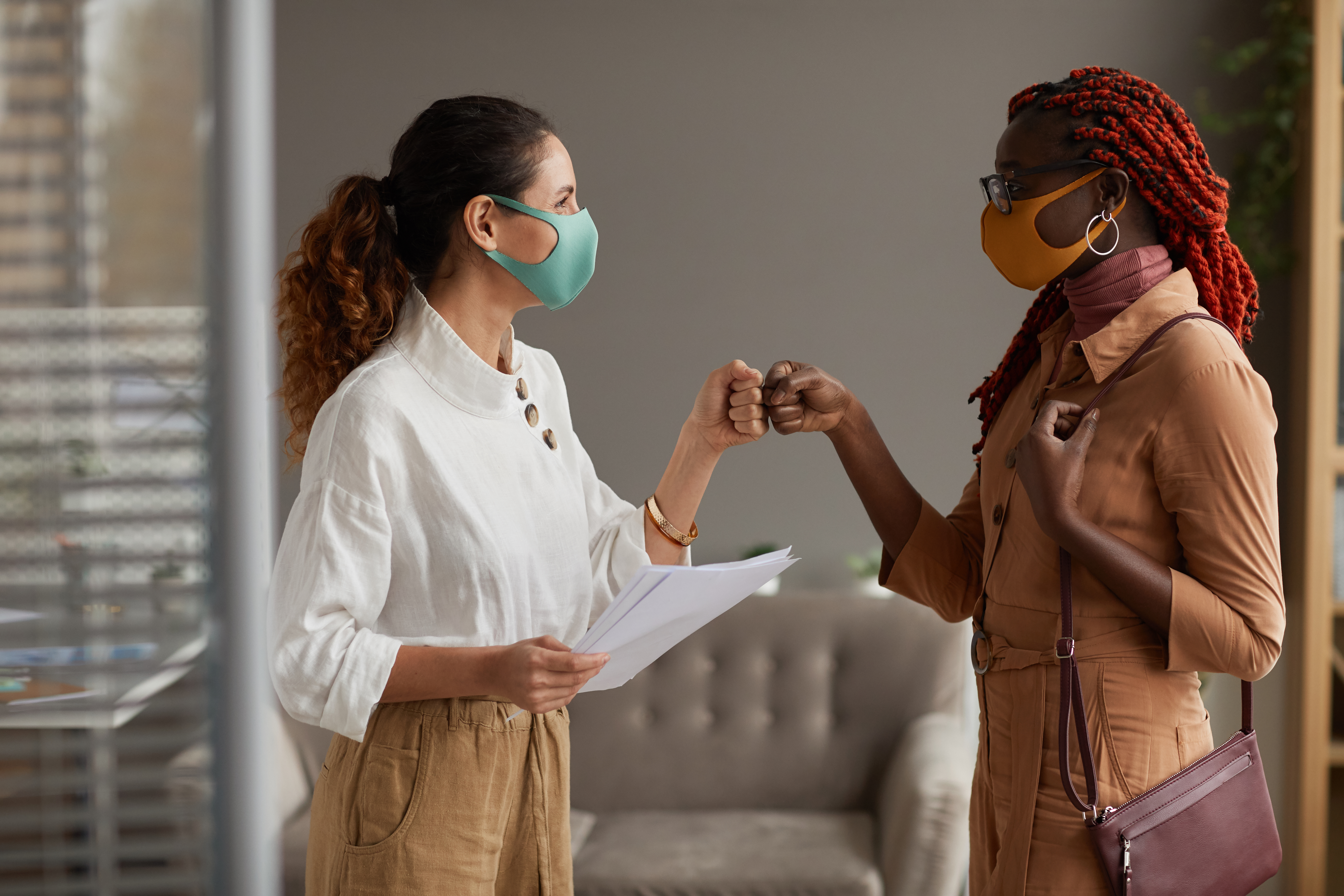 face to face greeting in masks during pandemic